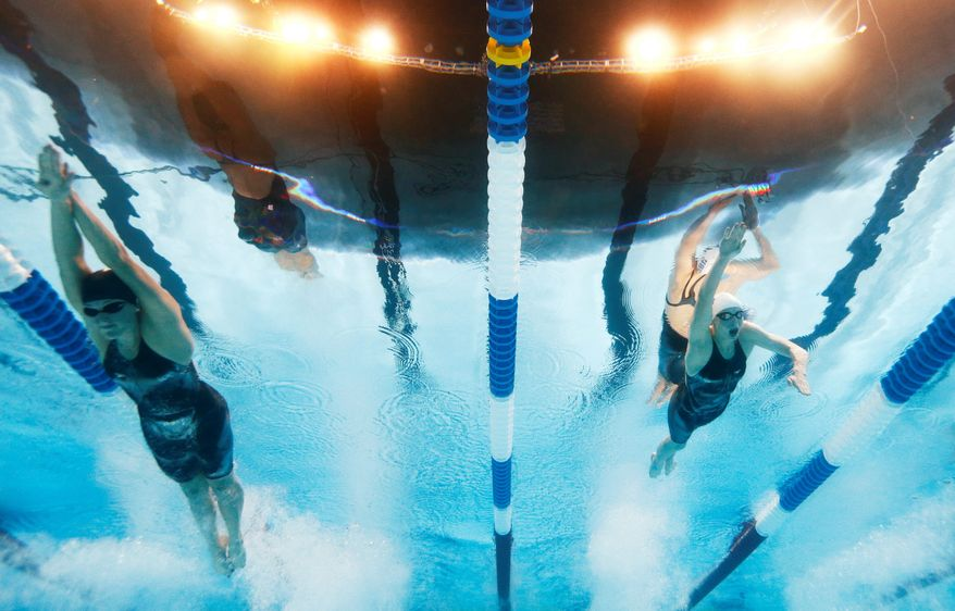 ** FILE ** Swimmers Katie Ledecky, Allison Schmitt and Chloe Sutton compete in the 400 freestyle final at the U.S. swimming trials in Omaha, Neb. (Associated Press)