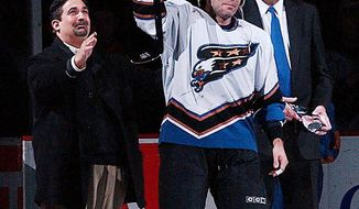 Adam Oates was named the Capitals' coach despite never having served as a head coach at any level. He did, however, construct a Hall of Fame playing career by scoring 341 goals and amassing 1,079 assists in 19 seasons. Below, as a member of the Capitals, he was honored for playing in his 1,000th NHL game. (Associated Press)