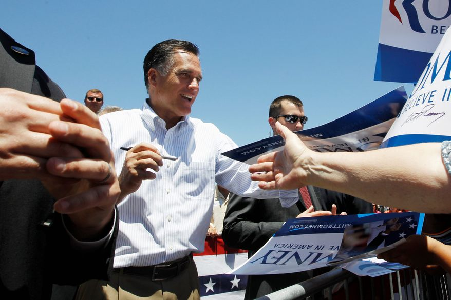 Republican presidential candidate Mitt Romney signs autographs while campaigning Tuesday at Carter Machinery Company Inc., in Salem, Va. As he moves closer to official nomination, Mr. Romney is being pressed for more specifics on key issues such as immigration, health care and women's pay, as well as fixing the economy. (Associated Press)