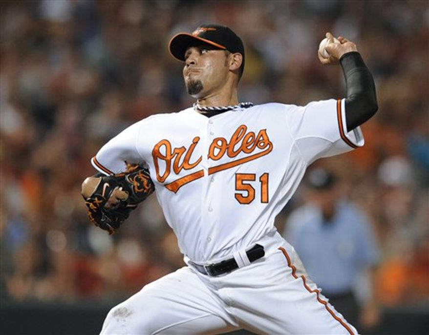 In this July 18, 2011, photo, Baltimore Orioles relief pitcher Mike Gonzalez throws to the Boston Red Sox during a baseball game in Baltimore. The Texas Rangers acquired Gonzalez from the Orioles for a player to be named. (AP Photo/Nick Wass)