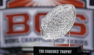 FILE - In this Jan. 9, 2012, file photo, the Coaches' Trophy is displayed before the BCS National Championship game between the LSU and Alabama in New Orleans. College football will finally have a playoff. Come 2014, the BCS is dead. A committee of university presidents on Tuesday, June 26, 2012, approved the BCS commissioners' plan for a four-team playoff to start in the 2014 season. (AP Photo/Gerald Herbert, File)