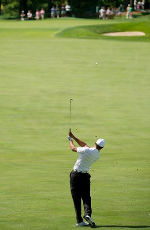Tiger Woods take practice on on the fourth hole before the start of the AT&T National golf tournament held at Congressional Country Club, Bethesda, Md., Tuesday, June 26, 2012. The tournament will begin on Thursday and run until Sunday. (Andrew Harnik/The Washington Times)