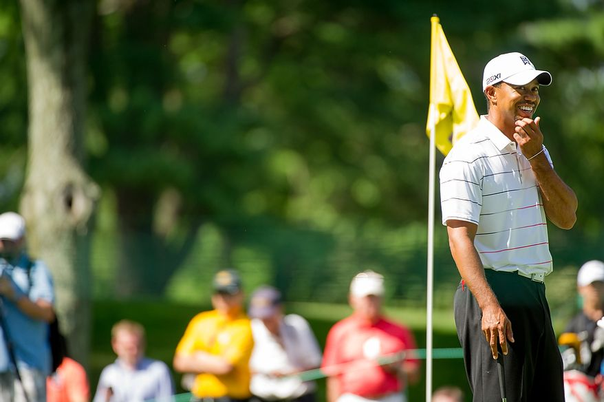 Tiger Woods smiles while taking putting practice on the fourth hole before the start of the AT&T National golf tournament held at Congressional Country Club, Bethesda, Md., Tuesday, June 26, 2012. The tournament will begin on Thursday and run until Sunday. (Andrew Harnik/The Washington Times)