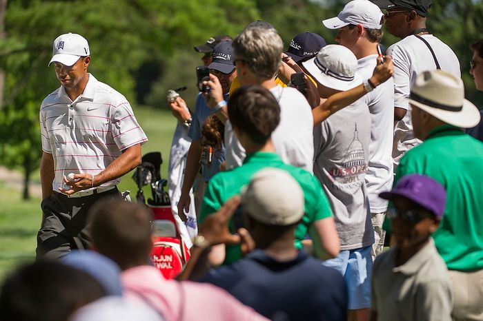 Fans gather to watch Tiger Woods as he makes his way to the fifth hole while taking practice before the start of the AT&T National golf tournament held at Congressional Country Club, Bethesda, Md., Tuesday, June 26, 2012. The tournament will begin on Thursday and run until Sunday. (Andrew Harnik/The Washington Times)