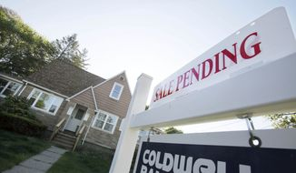 **FILE** A sign advertises a pending residential real estate sale in Framingham, Mass., on April 26, 2012. (Associated Press)