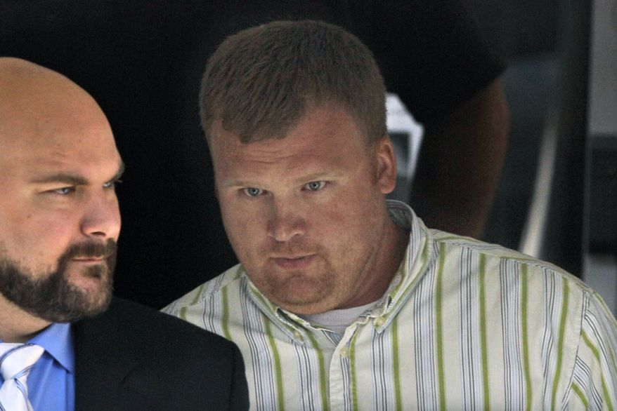 Matt Sandusky (right), adopted son of former Penn State assistant coach Jerry Sandusky, leaves the Centre County Courthouse in Bellefonte, Pa., on Wednesday, June 20, 2012, during his father's trial on child-sex-abuse charges. (AP Photo/Gene J. Puskar)