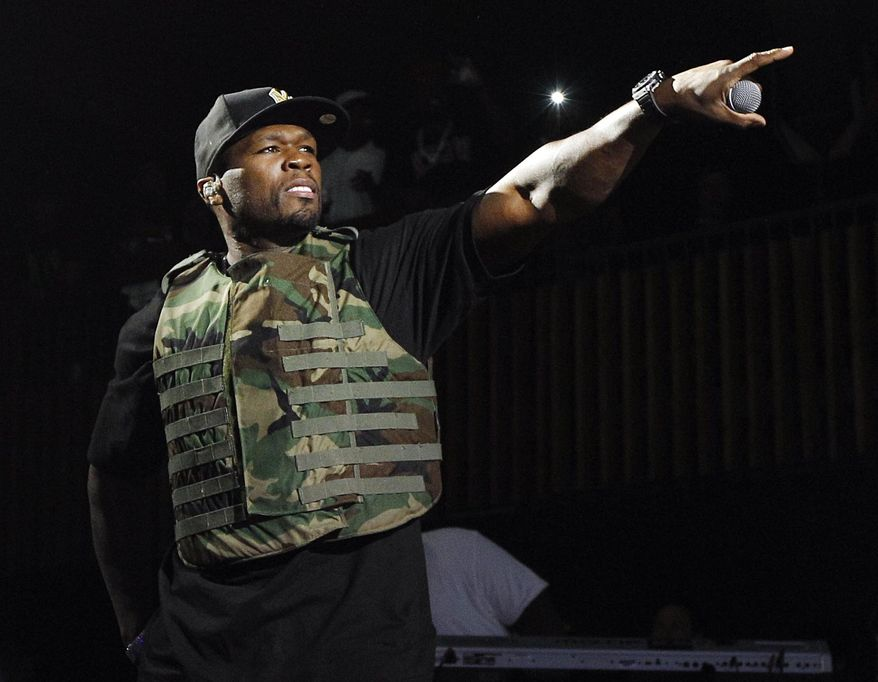 **FILE** Rapper 50 Cent, also known as Curtis Jackson, performs March 19, 2012, during the Fuse Live: Shady 2.0 SXSW concert at the Austin Music Hall in Austin, Texas. (Associated Press/Fuse, Brandon Wade)