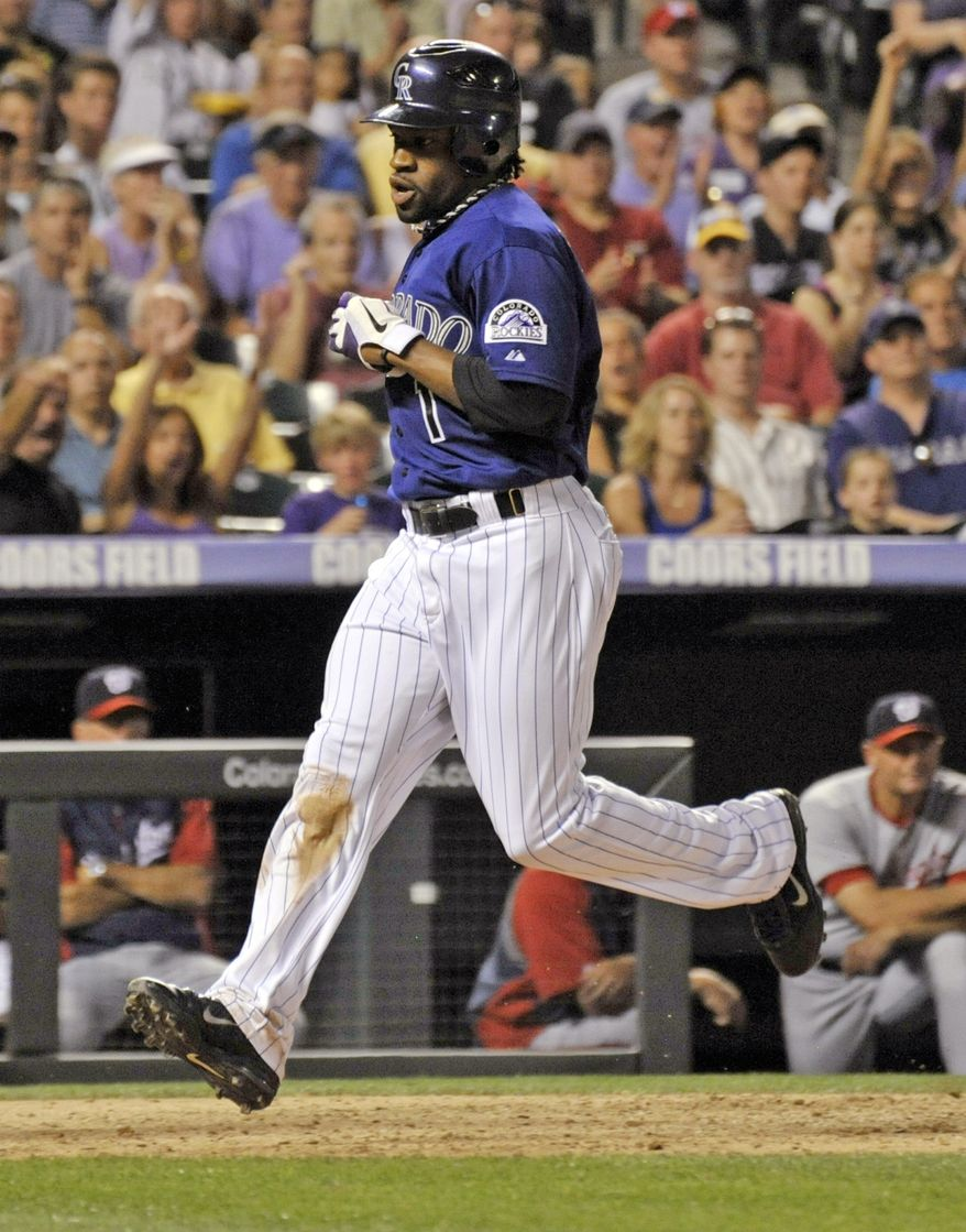 Colorado Rockies' Eric Young Jr. scores a run against the Washington Nationals during the seventh inning of a baseball game, Monday, June 25, 2012, in Denver. (AP Photo/Jack Dempsey)