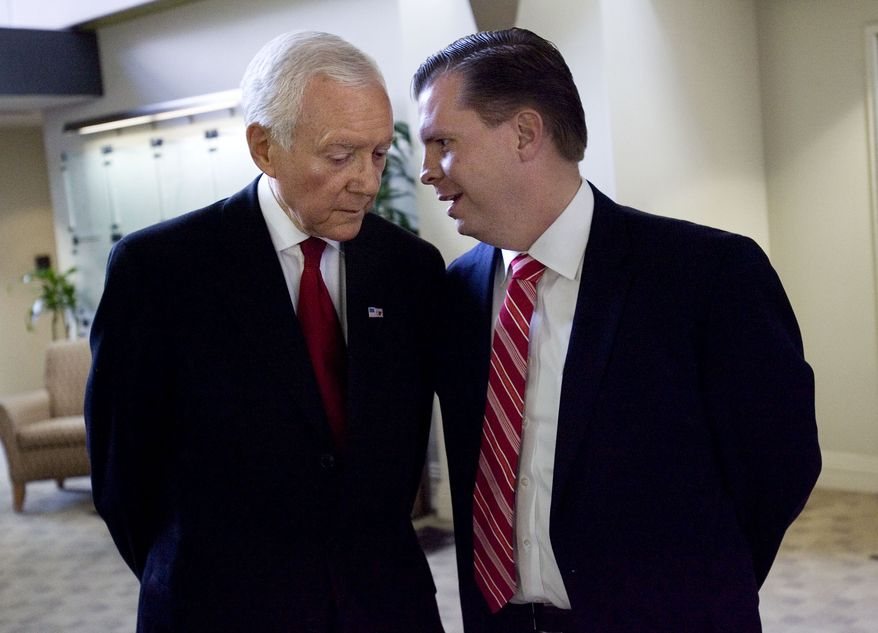 **FILE** Utah Sen. Orrin Hatch and Dan Liljenquist talk before participating in a debate at KSL Newsradio in Salt Lake City on June 15, 2012, eleven days before Utah's primary election. (Associated Press/The Deseret News)