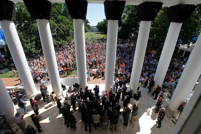University of Virginia president Teresa Sullivan, center, at podium, addresses a crowd of supporters outside the university Rotunda after she was reinstated by the Board of Visitors during a meeting at the school Tuesday, June 26, 2012 in Charlottesville, Va. The 15-member Board of Visitors voted unanimously to reinstate Sullivan less than three weeks after ousting her in a secretive move that infuriated students and faculty, had the governor threatening to fire the entire governing board and sparked a debate about the most effective way to operate public universities in an era of tight finances. Shortly after the vote, Sullivan thanked the board members for their renewed confidence in her. (AP Photo/Steve Helber)