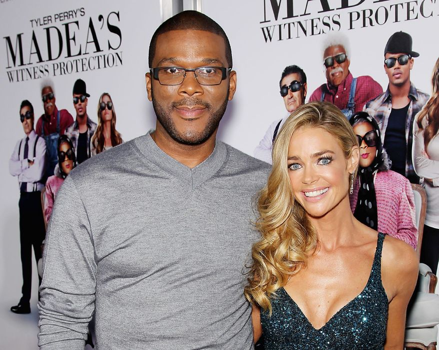 """Tyler Perry and Denise Richards attend the premiere of """"Tyler Perry's: Madea's Witness Protection"""" in New York. """"It's funny to see [Mr. Perry] as Madea,"""" Ms. Richards said. """"He's this hunky, gorgeous leading man. ... I don't know how Madea and Uncle Joe comes out of that."""" (Associated Press)"""