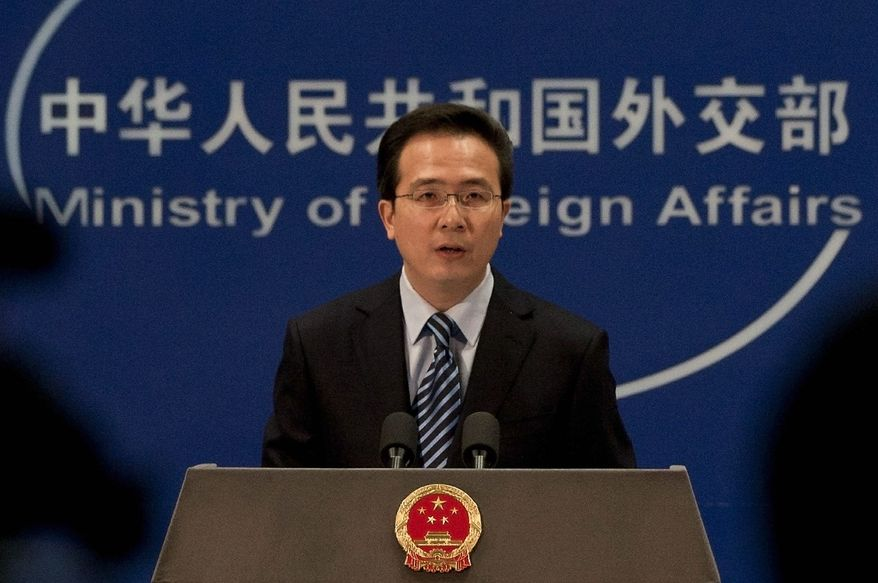 ** FILE ** Chinese Foreign Ministry spokesman Hong Lei speaks during a news briefing at the Ministry of Foreign Affairs in Beijing, China, Thursday, Dec. 8, 2011. (AP Photo/Andy Wong)