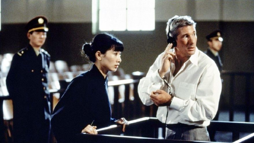"""China has been getting perceptibly friendlier treatment in American movies lately including Bai Ling and Richard Gere in """"Red Corner."""" (MGM Studios Inc. via Associated Press)"""