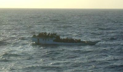 A boat carrying asylum seekers is pictured 120 miles north of Australia's Christmas Island in the Indian Ocean hours before it capsized on Wednesday, June 27, 2012. (AP Photo/Australian Maritime Safety Authority)