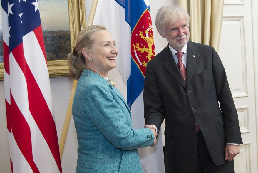 Secretary of State Hillary Rodham Clinton shakes hands with Finnish Foreign Minister Erkki Tuomioja on Wednesday, June 27, 2012, at the Government Banquet Hall in Helsinki. (AP Photo/Haraz N. Ghanbari, Pool)