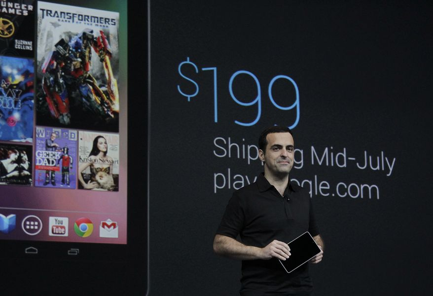 Hugo Barra, Google's director of product management, holds up the new Google Nexus7, that will sell for $199 and be available in mid-July, at the Google I/O conference in San Francisco on June 27, 2012. (Associated Press)