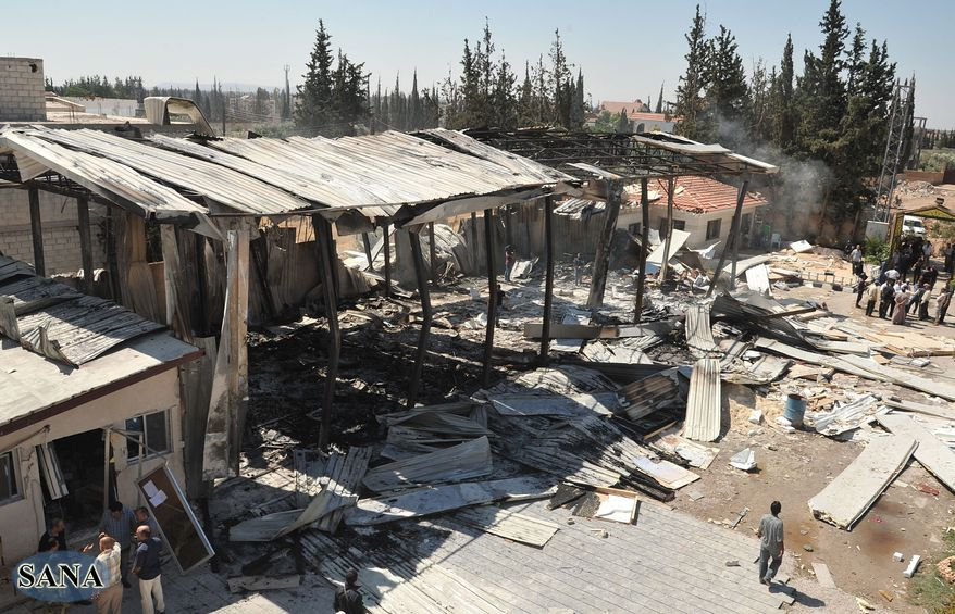 In this photo released by SANA, the Syrian official news agency, the damaged Ikhbariya TV compound is seen June 27, 2012, after it was attacked by gunmen in in the town of Drousha, about 20 kilometers (14 miles) south of Damascus. (Associated Press/SANA)