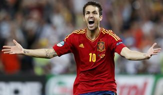 Spain's Cesc Fabregas celebrates after scoring the decisive penalty shootout during the Euro 2012 semifinal match between Spain and Portugal in Donetsk, Ukraine, on Thursday, June 28, 2012. (AP Photo/Jon Super)