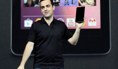 Hugo Barra, director of Google product management, shows off the new Google Nexus 7 tablet Wednesday. (Associated Press)
