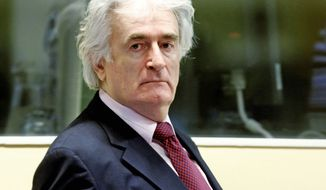 Former Bosnian Serb leader Radovan Karadzic was arrested in 2008. His trial started in 2009, and prosecutors rested their case in May. (Associated Press)
