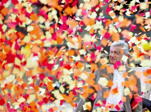 Andres Manuel Lopez Obrador, presidential candidate for the Democratic Revolution Party, greets supporters during the closing rally of his campaign at the main Zocalo plaza in Mexico City on Wednesday. Mexico will hold presidential elections on Sunday. (Associated Press)