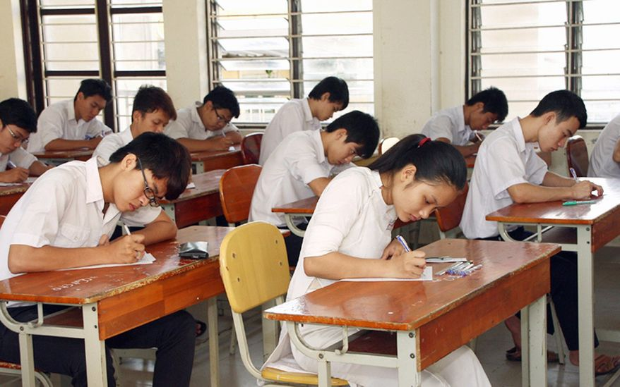 Students take the graduation exam June 3 at a high school  in Danang. Schools at all levels in Vietnam are rife with cheating and bribery. The result is that a record number of students are attending international-style private schools and later enrolling in overseas colleges and universities. (Associated Press)