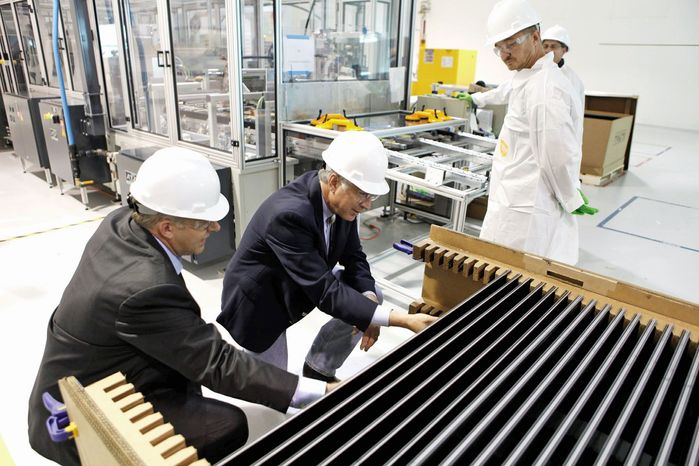 Secretary of the Interior Ken Salazar (second from left) examines solar electric panels at the Abound Solar Inc. manufacturing plant in Longmont, Colo., in 2009. The company borrowed about $70 million from the federal government only to file for bankruptcy and close its doors. The company also received nearly $12 million in tax credits. (Associated Press)