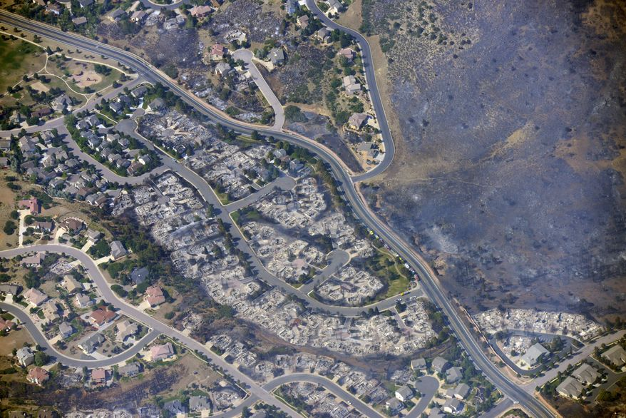 An aerial photo taken on Wednesday, June 27, 2012, shows burned homes in the Mountain Shadows residential area of Colorado Springs, Colo. (AP Photo/John Wark)