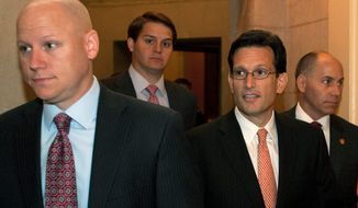 Surrounded by staff members, House Majority Leader Eric Cantor (center), Virginia Republican, leaves House Speaker John Boehner's office on Capitol Hill in Washington on June 28, 2012, after the Supreme Court's ruling on President Obama's health care law. (Associated Press)