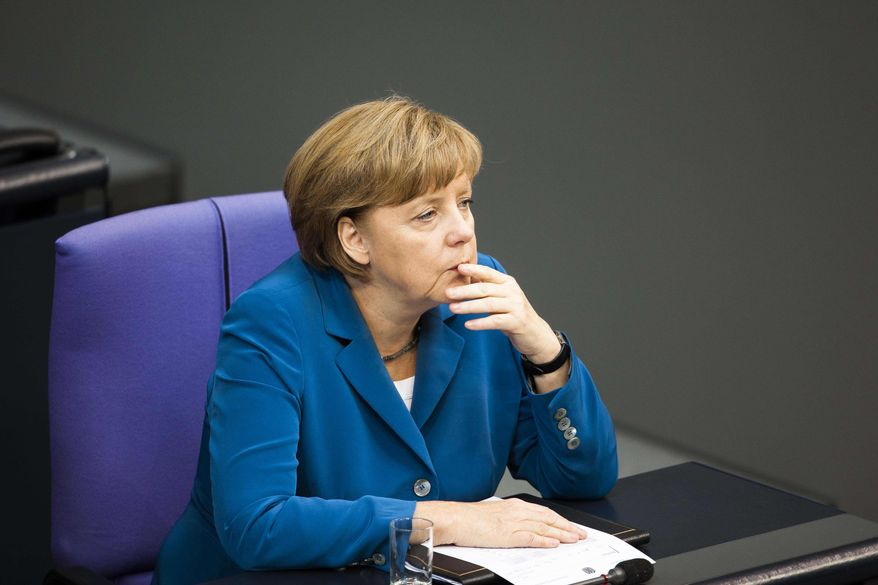 German Chancellor Angela Merkel reacts during the debate after her speech for the upcoming EU summit at the German parliament Bundestag in Berlin, Wednesday, June 27, 2012. (AP Photo/Markus Schreiber)