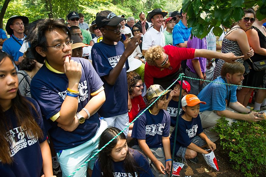 Large crowds gather to watch Tiger Woods tee off on the first hole to begin his round on the first day of the AT&T National golf tournament held at Congressional Country Club, Bethesda, Md., Thursday, June 28, 2012. (Andrew Harnik/The Washington Times)