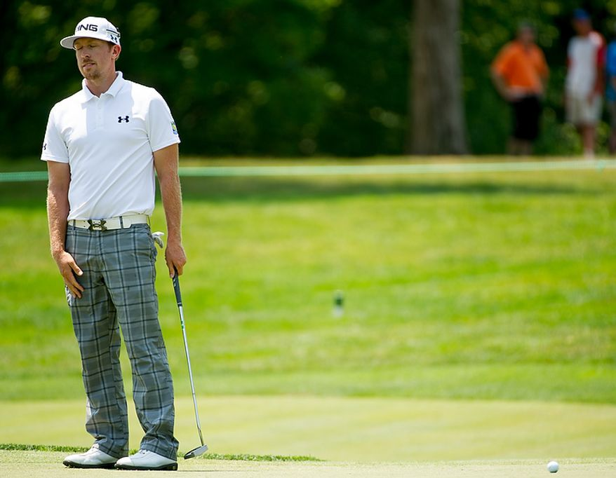 Hunter Mahan shows his frustration after missing a putt on the eighth hole on the first day of the AT&T National golf tournament held at Congressional Country Club, Bethesda, Md., Thursday, June 28, 2012. (Andrew Harnik/The Washington Times)