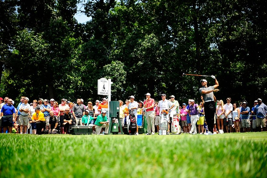 Tiger Woods hits a tee shot on the fourth hole at Congressional Country Club during first round play of the AT&T National golf tournament, Bethesda, Md., Thursday, June 28, 2012.  (Ryan M.L. Young/The Washington Times)