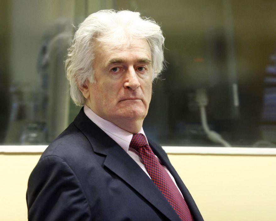 ** FILE ** In this Nov. 3, 2009, file photo former Bosnian Serb leader Radovan Karadzic enters the courtroom of the U.N.'s Yugoslav war crimes tribunal in The Hague, Netherlands. (AP Photo/Michael Kooren/Pool, File)