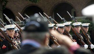 U.S. Marines parade at the Marine Barracks in Washington in this file photo taken Thursday, June 28, 2012. (The Washington Times) **FILE**
