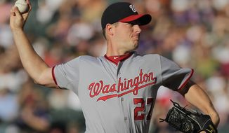 Washington Nationals starting pitcher Jordan Zimmermann tossed seven innings, giving up one run on eight hits and three walks in his team's 11-5 win over the Colorado Rockies on Wednesday night. (AP Photo/Barry Gutierrez)