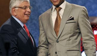 NBA Commissioner David Stern, left, poses with the No. 3 overall draft pick Bradley Beal, of Florida, who was selected by the Washington Wizards in the NBA draft Thursday, June, 28, 2012, in Newark, N.J. (AP Photo/Bill Kostroun)