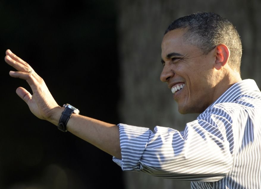 President Obama waves as he arrives to speak at a congressional picnic on the South Lawn of the White House on Wednesday, June 27, 2012. (Associated Press)