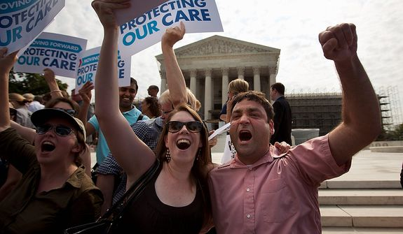 Claire McAndrew of Washington, left, and Donny Kirsch of Washington, celebrate outside the Supreme Court in Washington, Thursday, June 28, 2012, after the courts's ruling on health care.  (AP Photo/Evan Vucci)