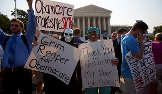 Demonstrators stand outside the Supreme Court in Washington, Thursday, June 28, 2012, before the court's ruling on health care.  (AP Photo/Evan Vucci)