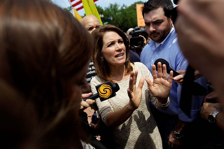Rep. Michele Bachmann, R-Minn, speaks outside the Supreme Court in Washington, Thursday, June 28, 2012, after the court's ruling on President Barack Obama's health care law was announced. AP Photo/David Goldman)