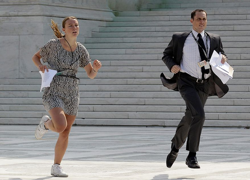 Members of the media run out of the Supreme Court in Washington, Thursday, June 28, 2012, after the court's ruling on President Barack Obama's health care law was announced. AP Photo/David Goldman)