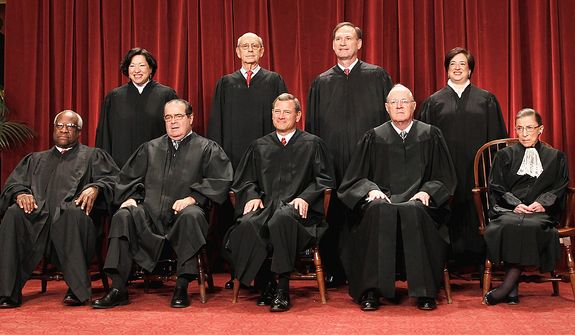 FILE - This Oct. 8, 2010 file photo shows the justices of the U.S. Supreme Court at the Supreme Court in Washington. Seated from left are Associate Justices Clarence Thomas, and Antonin Scalia, Chief Justice John Roberts, Associate Justices Anthony M. Kennedy and Ruth Bader Ginsburg. Standing, from left are Associate Justices Sonia Sotomayor, Stephen Breyer, Samuel Alito Jr., and Elena Kagan.  The Supreme Court on Thursday, June 28, 2012, upheld the individual insurance requirement at the heart of President Barack Obama's historic health care overhaul. (AP Photo/Pablo Martinez Monsivais, File)