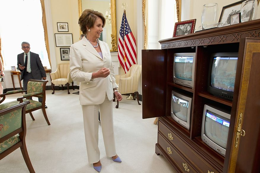 House Minority Leader Nancy Pelosi of Calif., smiles as she watches the breaking news from the Supreme Court which upheld the Affordable Care Act, Thursday, June 28, 2012 on Capitol Hill in Washington. Pelosi, the former speaker of the House, was instrumental in helping to pass health care reform in Congress and was at President Obama's side when he signed it into law.  (AP Photo/J. Scott Applewhite)