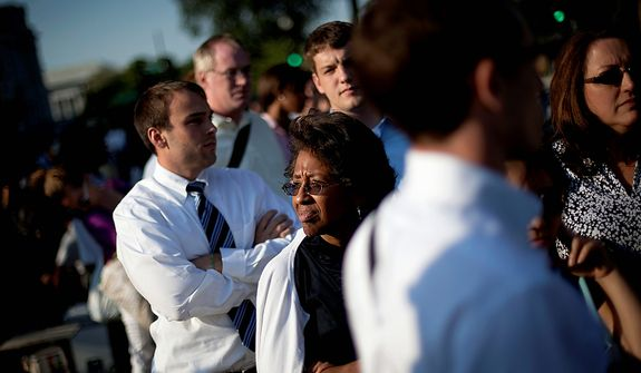 Joy Wilson of Washington, waits in line hoping for a pass to enter  the Supreme Court in Washington, Thursday, June 28, 2012. Saving its biggest case for last, the Supreme Court is expected to announce its verdict Thursday on President Barack Obama's health care law. (AP Photo/David Goldman)