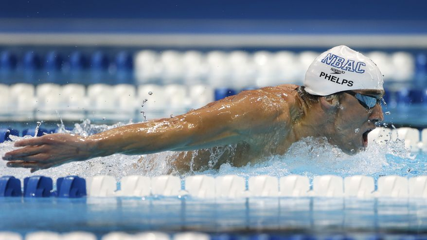 Michael Phelps swims to victory in the men's 200-meter butterfly final at the U.S. Olympic swimming trials on Thursday, June 28, 2012, in Omaha, Neb. (AP Photo/Mark Humphrey)
