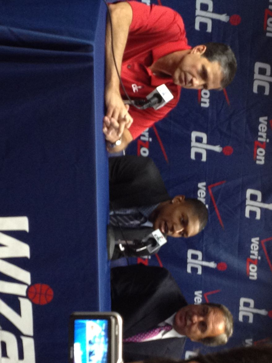 Newest Washington Wizard Bradley Beal sits next to coach Randy Wittman and team president and general manager Ernie Grunfeld on Friday during an introductory press conference. (Nicolas Nightingale/The Washington Times)