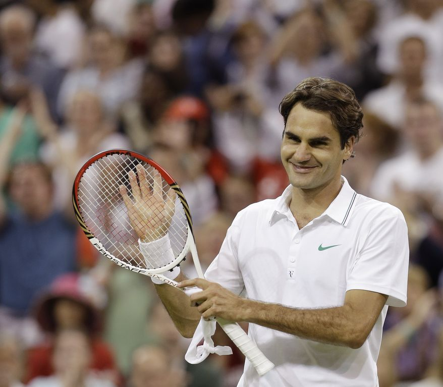 Roger Federer reacts after winning a third-round men's singles match against Julien Benneteau at the All England Lawn Tennis Championships at Wimbledon, England, on Friday, June 29, 2012. (AP Photo/Alastair Grant)