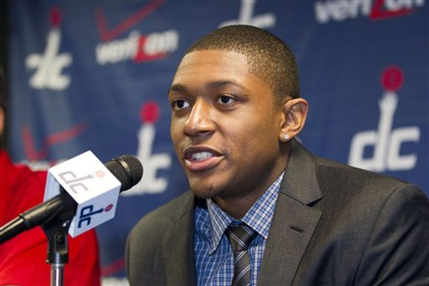Washington Wizards first round draft pick Bradley Beal speaks during a news conference at the Verizon Center in Washington, Friday, June 29, 2012. On the day he turned 19, the 6-foot-4 guard from Florida was drafted Thursday night as the third overall pick by the Wizards, a franchise looking for an outside shooter and a return to the postseason. (AP Photo/J. Scott Applewhite)