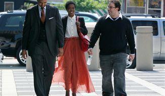 ** FILE ** Reclusive singer Lauryn Hill (center) arrives at federal court on Friday, June, 29, 2012, in Newark, N.J. (AP Photo/Mel Evans)